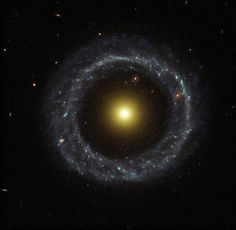 Hoag's Object is a mysterious ring galaxy 600 million light years awayin the constellation Serpens. The outer ring is composed largely of hotblue stars, while the core is older red and yellow stars. The space inbetween is almost completely dark. It is thought that this galaxyformed from the collision of two galaxies billions of years ago.Visible near the top of the gap is another ring galaxy, likely muchfurther away.