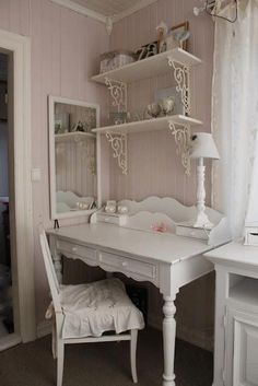 I love the pale pink walls, and the cute Victorian display shelves