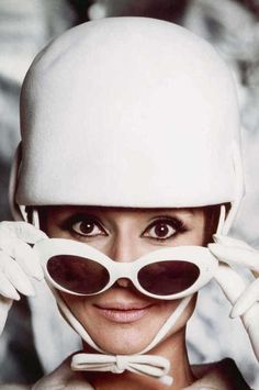 """The Fashion of Audrey The actress Audrey Hepburn as Nicole Bonnet and photographed by Douglas Kirkland at the Studio de Boulogne to a fashion editorial and also for the publicity of """"How to Steal a Million"""". Paris (France), 1965. -Audrey was wearing creations of Givenchy (hat and wool suit, jacket and skirt), leather gloves of Hermès and Oliver Goldsmith sunglasses."""