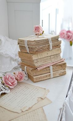 Shabby Chic Books. Buy some hardcover ones at Goodwill and take both covers off and the binder so they are down to only the paper. You can ruffle the pages after you antique them some. Make them look worn and then tie them up with a flower on top.