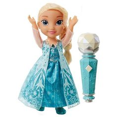 """Now your kiddo can create the perfect duet with Disney Frozen Sing-A-Long Elsa. The magical microphone can recognize who's singing so Elsa can sing along. First, place the microphone near Elsa's mouth to hear her sing the full length version of the award winning song """"Let it Go,"""" then start singing your favorite part with the mic and have Elsa pick up where you leave off. Pass the microphone back and forth to create the perfect duet. Watch Elsa's necklace and dress light up as you Sing-A-Lon..."""