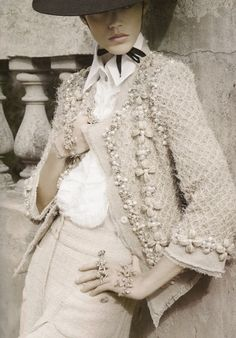 Another shot of this chanel jacket, and I actually love the high waisted trousers here, too.