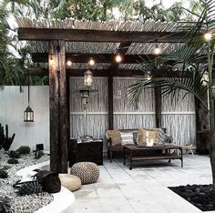 I love this bamboo covered pergola. What a peaceful and romantic spot.
