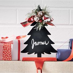 "Metal chalkboard tree with faux greenery and plaid bow. 5 1/2"" w x 9 1/2"" h x 3 1/2"" d"