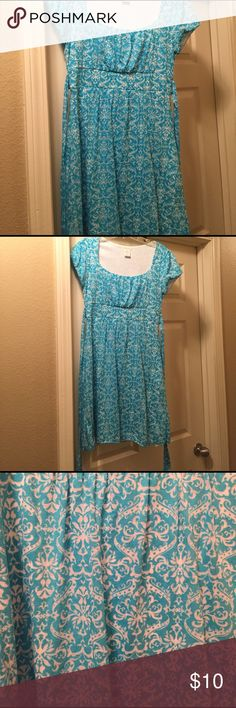 """Maurice's fleur de lis blue dress This fleur de lis pattern dress is perfect for spring! Has cap sleeves & ties in the back. The color is bright blue with cream patterns. I am 5'7"""" and it hits be right above the knee. Only worn a few times. Size small, 53% polyester & 47% cotton. Maurices Dresses Midi"""