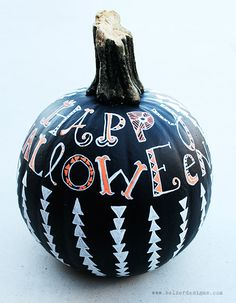 Concept of White Sharpie Decorated Pumpkins