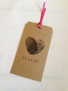 Save the Date Tag designed by @Rose Pendleton Pendleton mountague www.rosemountague.co.uk printed on brown paper.