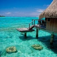 over the water bungalows in tahiti | Top 5 over water bungalows | Escape Travel Blog