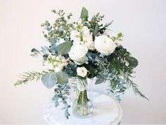 bouquet of whites and soft blues ~ ranunculus, roses and eucalyptus