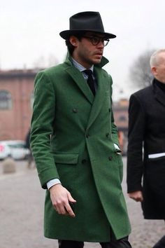 Nail that dapper look with a green overcoat and a white and navy vertical striped oxford shirt. Shop this look for $1,691: http://lookastic.com/men/looks/black-hat-and-white-and-navy-dress-shirt-and-black-tie-and-green-overcoat/3868 — Black Hat — White and Navy Vertical Striped Dress Shirt — Black Tie — Green Overcoat