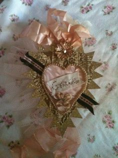 Pinner said...My miligros heart altered art by pinkpomegranate, via Flickr