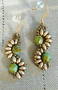 Green Picasso beads with matte gold super duos Seahorse shape earrings These earrings are 1 3/4 inch long and 1/2 inch wide