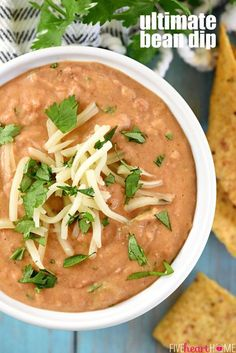 Ultimate Bean Dip ~ requiring a handful of simple ingredients -- refried beans, cream cheese, salsa, pepper jack, and cilantro -- and taking just 10 minutes to make, this stove-top appetizer recipe is creamy and cheesy...the perfect snack for parties or for watching the big game! | FiveHeartHome.com