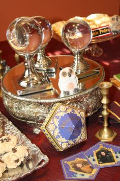 Harry Potter Centerpiece Inspiration  http://www.eventtrender.com/blog/2011/10/conjure-up-a-spellbinding-harry-potter-tablescape.html