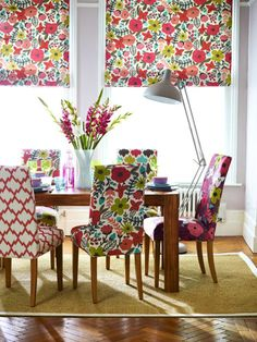 A lively dining room featuring mismatched prints, bright and daring, a fun change that stirs things up! Mismatched Dining Chairs, Upholstered Dining Chairs, Dining Room Chairs, Dining Area, Lounge Chairs, Floral Room, Floral Fabric, Floral Prints, Bright Rooms