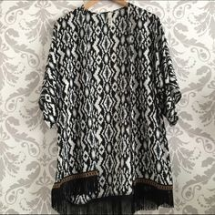 Aztec Print Fringe Cardigan Lightweight piece for layering; beautiful print with a detailed hem and fringe. Throw this on over a simple tank or tee to take your look to the next level! Polyester; made in USA Rachel Kate Tops