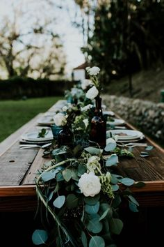 Wood farm table, green table garland, vintage bottles, white flowers Image by Jessie Schultz Photography Wedding Locations California, California Wedding, Wedding Table Decorations, Wedding Centerpieces, Irish Wedding Traditions, Table Garland, Wedding Bottles, Green Table, Farm Wedding