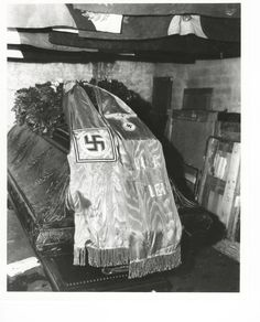 Not only did the Nazi's hide art, but they also hid bodies. Pictured; the coffin of Frederick the Great as it was found, draped with a Nazi flag, in a salt mine, May 1, 1945. The caskets of former Weimar President Paul von Hindenburg and his wife were found there too. The Germans had hidden them to conceal them from the approaching Russian troops. When the war ended, US troops made it to the mine first.