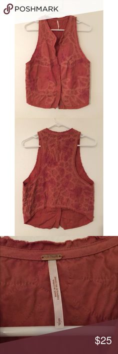 "FREE PEOPLE rust colored button front vest size S FREE PEOPLE size Small, rust colored, lace, distressed vest with front snap closures. 3 snaps down the front. Pretty detail on front and back of vest. No holes or stains that I have seen or found. Can be worn open or closed.   17"" front closure length  14"" shoulder to armpit opening 22"" shoulder to bottom hem length 16.5"" back length Free People Jackets & Coats Vests"