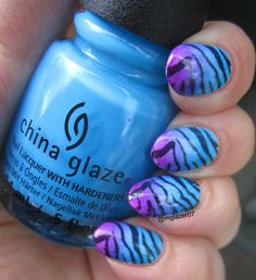 "For this manicure, I created a gradient using China Glaze's ""DJ Blue My Mind"" and ""Violet-Vibes"" from their Summer 2015 Electric Nights Collection over a white base, then used Sinful Colors ""Black on Black"" to stamp an image from a plate from an ""As Seen on TV"" ""Salon Express"" plate."