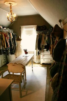 This is a cute closet...no built ins, but dresser, table, chair, lighting...
