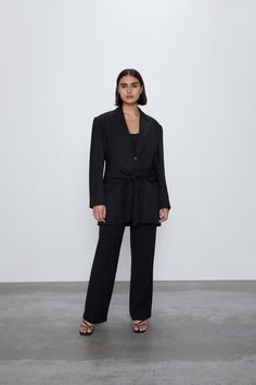 Long blazer with a lapel collar and long sleeves. Front flap pockets and a false welt pocket on the chest. Tie detail at the waist. HEIGHT OF MODEL: 177 cm. Zara Suits, Zara Home Stores, Long Blazer, Belt Tying, Jumpsuit, Normcore, Tie, Long Sleeve, United Kingdom