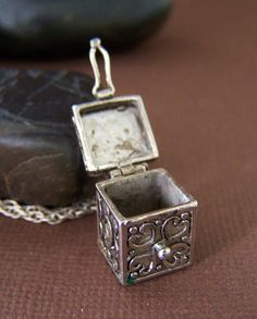 Hinged box with clasp