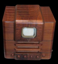 "The first TV in the US - The ""Andrea 1F5"" was one of the television sets of the first hour. The brand ""Andrea"" was named after Frank Angelo D'Andrea. D'Andrea used ""Andrea"" as well as ""FADA"" (i.e. the initials of his name) as brand names for his television sets. The cabinet of this set here was restored to an original  finish. The wood grain and veneer work on the cabinet are stunning examples of the art."