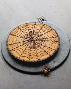 """Chocolate crust filled with creamy pumpkin puree filling. Dress it up for Halloween using melted semisweet chocolate piped over the top in a spiderweb pattern and add a few totally yucky fake spider """"friends."""""""
