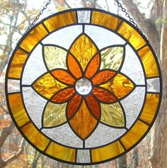 Golden colors of autumn in this round geometric stained glass pattern. USE Sun face nuggets around the boarder for an EXTRA effect. Three different shades of warm amber stained glass, this design measures 10 inches diameter. Can put into a square design. Stained Glass Paint, Stained Glass Flowers, Stained Glass Designs, Stained Glass Panels, Stained Glass Projects, Stained Glass Patterns, Mosaic Glass, Fused Glass, Glass Art