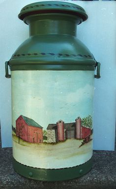 I'm so lucky to own this milkcan from the farm.  I had the late Dot Wolfinger, a Bucks County artist,  paint the barn on it! Photo by Carol Jacobs Norwood.