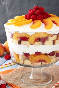 Peach Raspberry Sangria Trifle - peaches are soaked in white wine, then layered with raspberries, pound cake and fresh whipped cream! A light and easy summer dessert! by ursula Trifle Bowl Recipes, Trifle Desserts, Trifle Recipe, Easy Desserts, Delicious Desserts, Yummy Food, Dessert Trifles, Fruit Trifle, Layered Desserts