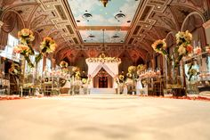 It's a #magicalmonday featuring this warm, modern Ceremony @thebreakers with @carriezackevents #alwaysflowersevents