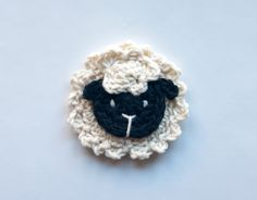 Crochet a sheep (refrigerator magnet, bookmark- add icord and end with tail).