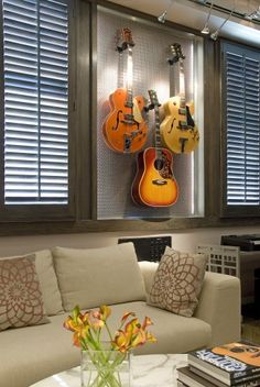 Idea for guitar display instead of leaving them on stands in the closet to get all dusty. Guitar Storage, Guitar Display, Home Music Rooms, Music Studio Room, Guitar Wall, Guitar Room, Home Recording Studio Setup, Music Wall, Room Themes