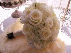 powder blue hydrangea,white roses and lisianthus
