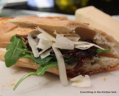 French Onion Jam baguette sandwiches with gruyere cheese and baby arugula