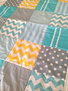 Baby Crib Quilt by Alphabet Monkey. I just love the fabrics for this.