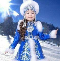 Beautiful sakha child in amazing traditional costume. Yakutia, Russia