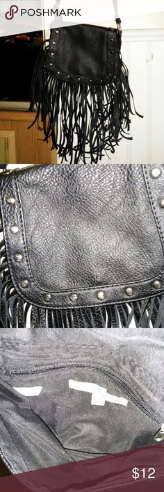 Crossbody Faux Leather Fringe Purse Carried a few times, inside zipper works. No rips or stains in/on lining. Snap closer. Has sliver studs. Charlotte Russe Bags Crossbody Bags