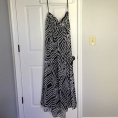 White House black market strapless dress! Black and white printed chiffon dress with black lining. Very flattering and perfect for a wedding. Can be dressed up or down! Worn twice...in great condition! White House Black Market Dresses Maxi