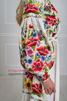 Well, isn't it lovely that this linen dress is completely strewn with wildflowers? A maxi dress attracts attention not only with bright floral embroidery but also with beautiful details in the form of the seams of the sleeve, as well as the belt that beautifully emphasizes the waist. In this linen