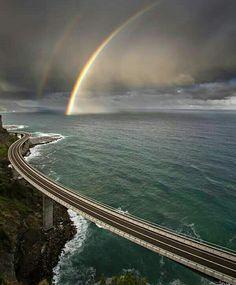 A Rainbow Dipping into Ocean