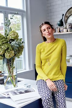 You had me at 'yellow.' Meet your transitional wardrobe saviour. This classic crew jumper is soft, versatile and ultra-flattering. It's light enough to keep you cool on warmer days but snug enough to keep you warm when the sun goes down. However you wear it, make sure you show off those gold buttons on the cuff.