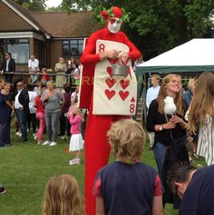 Red Card Stilts to hire worldwide perfect for all Alice in Wonderland themed events and weddings. Manchester, Brighton, London, Birmingham