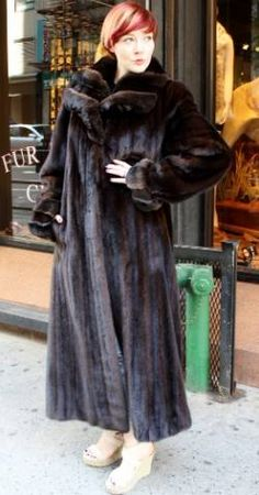 712b194d72 Marc Kaufman Furs Presents a dark brown mahogany mink fur coat with  chinchilla fur collar from