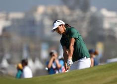 Paula Reto of South Africa chips onto the ninth green during the first round of the women's golf competition in the Rio 2016 Summer Olympic Games at Olympic Golf Course.