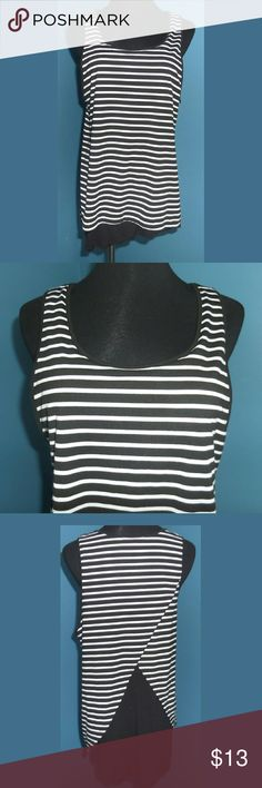 "Black Striped Tank Flyaway Back Sleeveless. Layered. Black striped top with black underlayer. Bottom part has a slanted hem.   Length: 26"" Pit to pit: 19"" -measured flat-  *~* Bundle & Save *~* Retro-ology Tops Tank Tops"