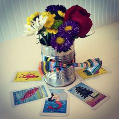 Easy fiesta centerpieces with loteria cards, cans, flowers and fabric !