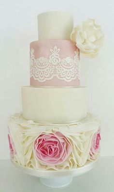 Wedding cake in shades of ivory and pale pink.